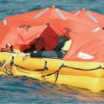 Ocean Safety inflatable liferaft on the water